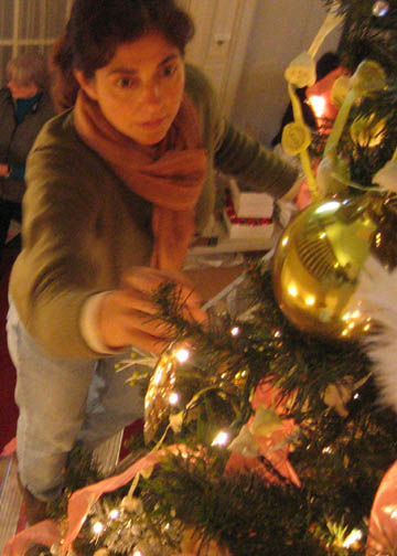 Gail on the pruning ladder decorating the big tree