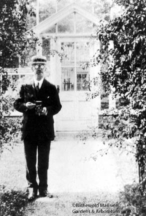 Alfred Rehder taking pictures near the greenhouse