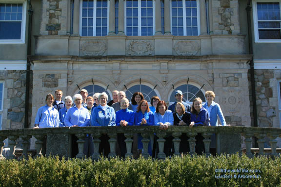 Family portrait of the staff and volunteers wearing Blue For Mary