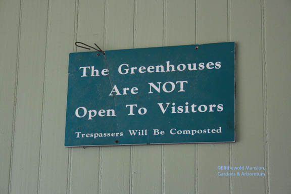 The sign that hung on the greenhouse door before it was safe for visitors to visit.