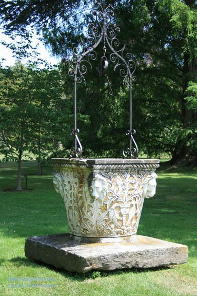 A decorative wellhead near the North Garden