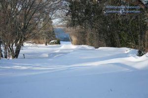 snow drifts on the lane