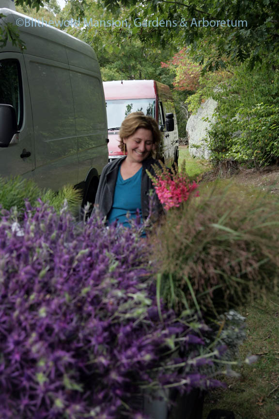 Polly showing off cut snapdragons and Eryngium leavenworthii at Robin Hollow Farm