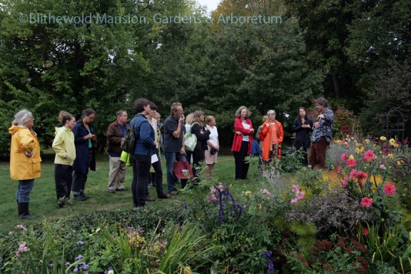 Pam, Julie and Christine take a closer look at a perennial in the North Garden